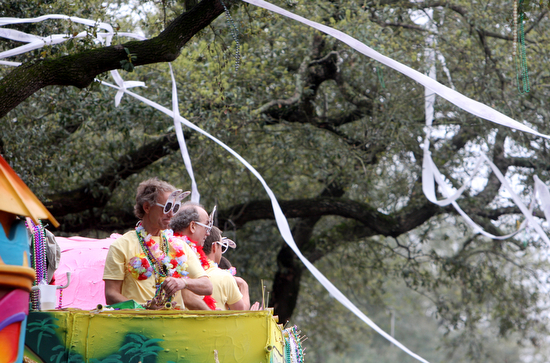 Rolls of toilet paper stream from the trees above Krewe of Tucks floats in 2011. (Sabree Hill, UptownMessenger.com)