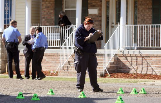 Police investigate a fatal shooting in 2011 on Monroe Street just outside an elementary school while classes were in session. (UptownMessenger.com file photo by Sabree Hill)