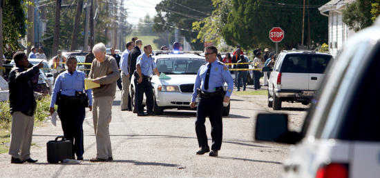 Police investigate a fatal shooting on Monroe Street half a block from Johnson Elementary School in November 2011. (UptownMessenger.com file photo by Sabree Hill)