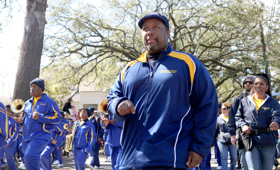 """""""Treme"""" actor Wendell Pierce marches with students from his character's school in the Krewe of Carrollton in February 2012. (Sabree Hill, UptownMessenger.com)"""