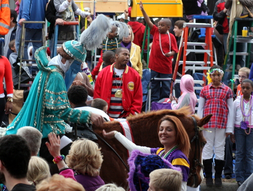 Ladders form a backdrop to the Krewe of Proteus on Napoleon Avenue in 2012. A proposed new law would require all ladders be six feet back from the curb. (UptownMessenger.com file photo by Robert Morris)