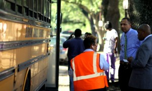 RSD Superintendent Patrick Dobard stands outside a school bus on Napoleon Avenue in 2012. (UptownMessenger.com file photo)