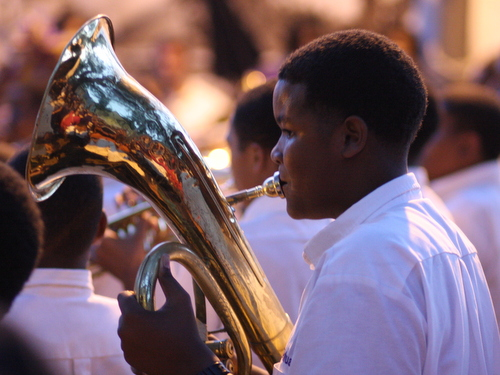 A member of the St. Augustine Marching 100 plays in the Battle of the Bands for the Instruments A-Comin' benefit at Tipitina's in April 2012. (UptownMessenger.com file photo by Robert Morris)