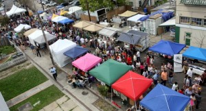 Crowds fill Freret Street between the vendor tents during the Freret Street Festival in 2013. (UptownMessenger.com file photo by Robert Morris)