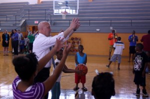 Mayor Landrieu shoots baskets in the rebuilt Lyons Center gym at the reopening ceremony in June 2013. (UptownMessenger.com file photo by Robert Morris)