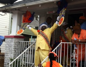 Erone Hymel emerges from his mother's house on Loyola Avenue at the beginning of the Uptown Swingers second line on June 24, 2013. (UptownMessenger.com file photo by Robert Morris)