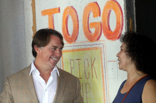 John Besh greets a neighbor of the his new Pizza Domenica restaurant proposed for 4933 Magazine Street. (Robert Morris, UptownMessenger.com)