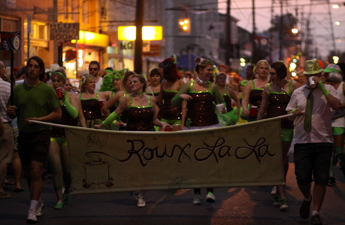 Roux La La dances down Oak Street in the Krewe of OAK parade. (Robert Morris, UptownMessenger.com)