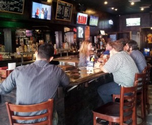 Patrons line the bar for a Fat Harry's lunch on Friday afternoon. (Robert Morris, UptownMessenger.com)