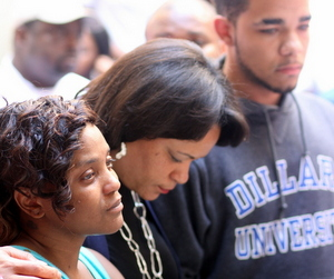 City Councilwoman LaToya Cantrell (center) grasps hands with Andrea Samuels and Keion Reed on Sept. 1, the day after their 1-year-old baby was killed in Central City gunfire. (UptownMessenger.com file photo by Robert Morris)