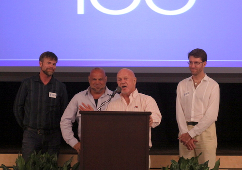 John Hill, center, a former director of the Forum for Equality whose house was the target of anti-gay vandalism, introduces other victims of hate crimes at a forum at the Jewish Community Center on Tuesday. (Robert Morris, UptownMessenger.com)