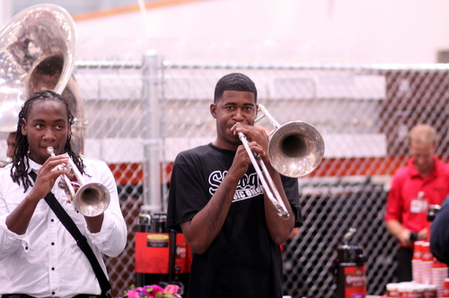 The Stooges Brass Band play during the Costco grand opening ceremonies. (Robert Morris, UptownMessenger.com)