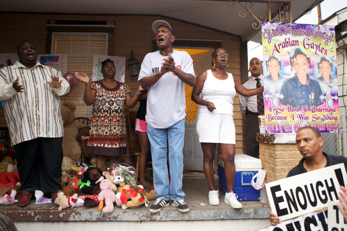 Friends, family and community members gather at the vigil for  Arabian Gayles. (Sabree Hill, UptownMessenger.com)