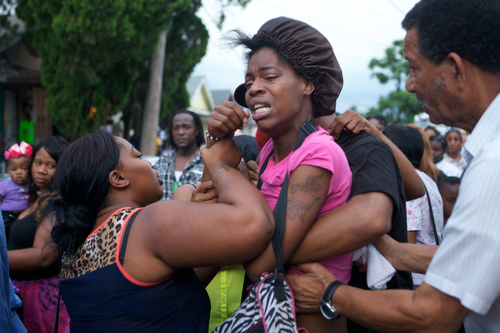 Tracey Moffet screams with pain before passing out at the vigil for Arabian Gayles. (Sabree Hill, UptownMessenger.com)