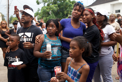 Sierra Gayles , sister of Arabian Gayles, and friend Armani Hooks, hold each other during the vigil. (Sabree Hill, UptownMessenger.com)