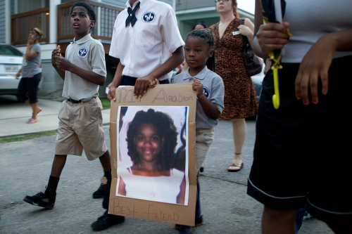 Friends, family and community leaders march during the vigil. (Sabree Hill, UptownMessenger.com)