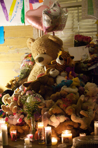 Stuffed animals, balloons and candles at the vigil for Arabian Gayles. (Sabree Hill, UptownMessenger.com)