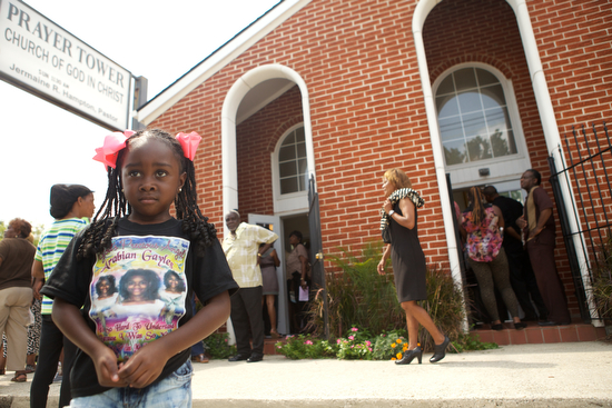 """Damari Anderson, 5, wears a shirt reading """"God's Precious Angel"""" at the funeral of Arabian Gayles. (Sabree Hill, UptownMessenger.com)"""