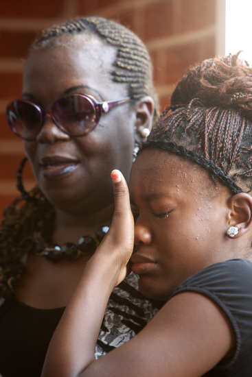 Mourners at the Prayer Tower Church of God in Christ for the funeral service of 11-year-old Arabian Gayles. (Sabree Hill, UptownMessenger.com)