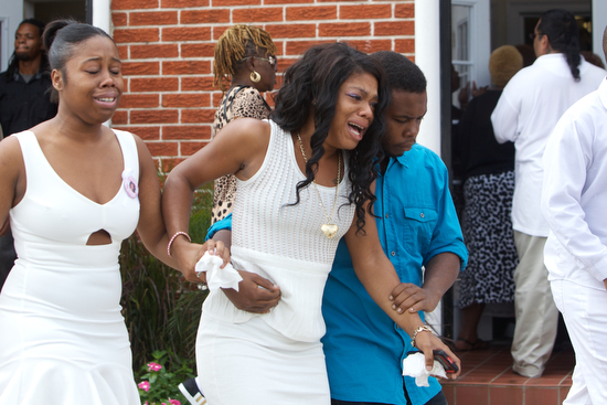 Mourners leave the funeral service of 11-year-old Arabian Gayles. (Sabree Hill, UptownMessenger.com)