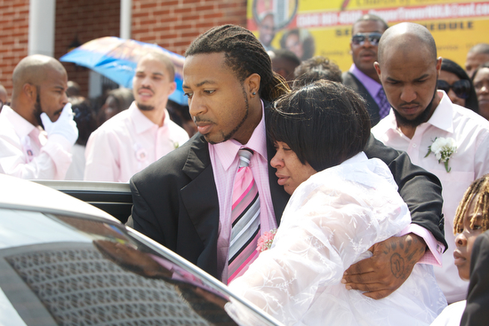 Ashley Moffet, mother of Arabian Gayles,  leaves her daughters funeral.  (Sabree Hill, UptownMessenger.com)
