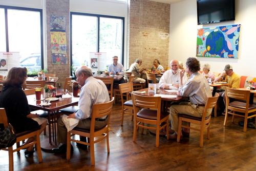 Guests enjoy lunch at Cafe Reconcile Thursday afternoon. (Sabree Hill, UptownMessenger.com)