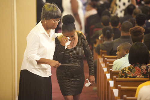 A woman wipes a tear from her eye at the funeral of 1 year-old Londyn Samuels. (Sabree Hill, UptownMessenger.com)