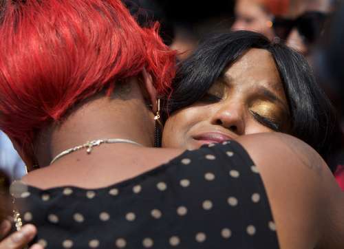 Andrea Samuels, mother of Londyn Samuels, cries as she is comforted by family and friends at her daughter's funeral. (Sabree Hill, UptownMessenger.com)