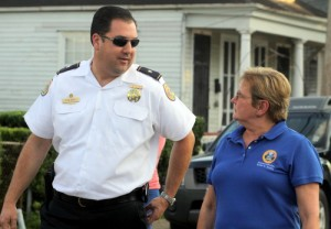 NOPD Second District Commander Paul Noel talks to City Councilwoman Susan Guidry during Wednesday's anti-crime march. Guidry chairs the criminal-justice committee that held Wednesday's hearings on NOPD staffing. (Sabree Hill, UptownMessenger.com)