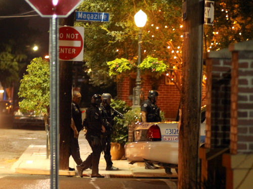 The SWAT Team marches on Magazine Street. (Robert Morris, UptownMessenger.com)