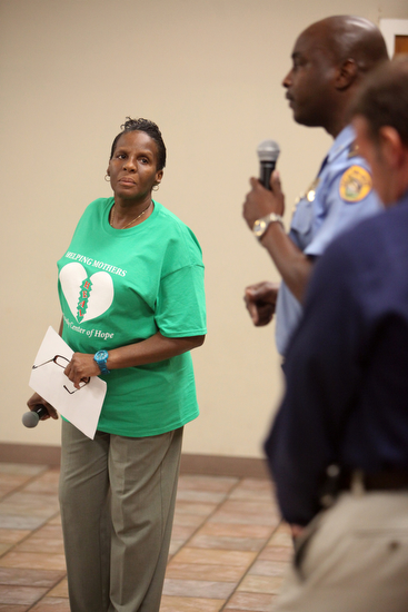 Cathy Rogers listens as NOPD Lt. Shaun Ferguson addresses a question asked about how cold cases are handled. (Sabree Hill, UptownMessenger.com)
