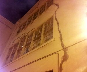 Temporary patching can be seen on long cracks on a courtyard wall at the International School of Louisiana's Camp Street campus Wednesday night. (Robert Morris, UptownMessenger.com)