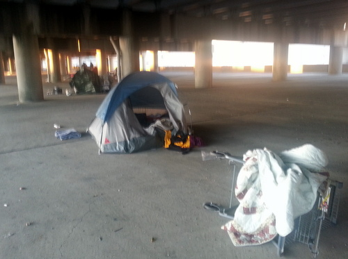 The blue tent where people staying under the Pontchartrain Expressway said a woman was found dead Wednesday afternoon. (Robert Morris, UptownMessenger.com)