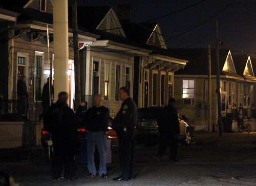 Police investigate a fatal shooting in the 4500 block of South Robertson. (Robert Morris, UptownMessenger.com)