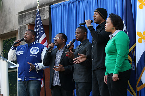 "City Councilwoman LaToya Cantrell and a group from Franklin Avenue Baptist Church sing ""We Shall Overcome"" in front of City Hall before the 27th annual MLK Jr. Day parade."