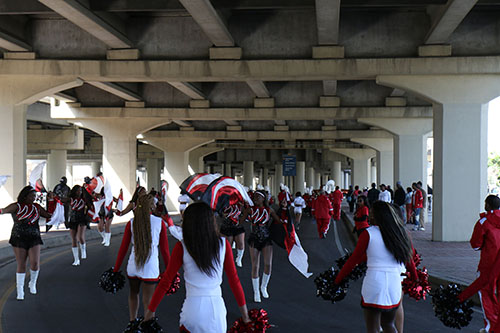 Martin Luther King Jr. Charter School cheerleaders parade under the overpass during the 27th annual MLK Jr. parade. (Zach Brien, uptownmessenger.com)