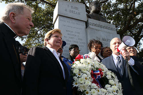New Orleans mayor Mitch Landrieu (far right) gives his final remarks alongside Archbishop Gregory Aymond (left) and City Councilwoman Susan Guidry (middle) after a wreath was brought to the MLK Memorial on Claiborne Ave. (Zach Brien, UptownMessenger.com)