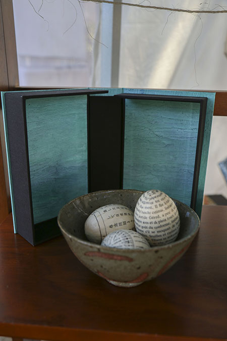 Eggs made of old library books by Yuka Petz