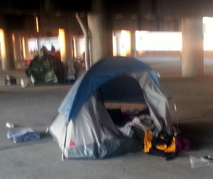 The tent where a woman in her 50s was found dead under the Pontchartrain Expressway on Wednesday. (UptownMessenger.com file photo by Robert Morris)