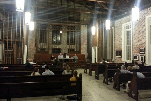 Members of the Coliseum Square Association meet Monday night in the Felicity Church, which is under renovation by a private owner. The association has been advocating for a similar future for the nearby Spanish-American Church building on Sophie Wright Place. (Robert Morris, UptownMessenger.com)