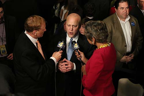 New Orleans mayor Mitch Landrieu speaks with Eric Paulsen (left) and Sally-Ann Roberts (right) of WWL TV
