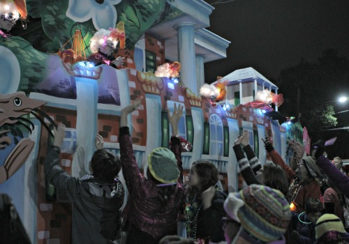A crowd at Mystic Krewe of Nyx reaches for beads (Della Hasselle, MidCityMessenger.com).