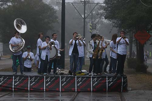 Green Wave brass band performs for runners at the corner of Octavia and St. Charles. The brass band was one of six bands playing along the route.