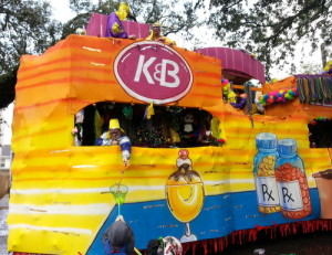 The Krewe of Alla's K&B float rolls on Magazine Street. Officials have not said which floats the riders who were injured fell from. (Robert Morris, UptownMessenger.com)