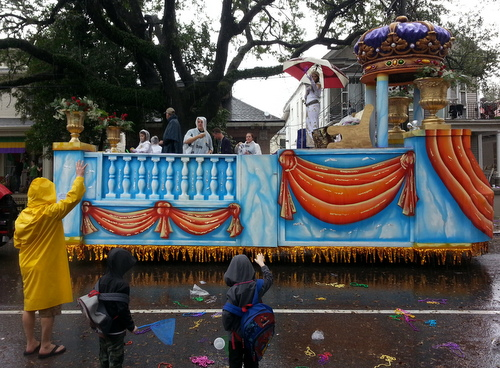 The queen of the Krewe of Alla holds an umbrella as her float rolls on Magazine Street in the rain. (Robert Morris, UptownMessenger.com)