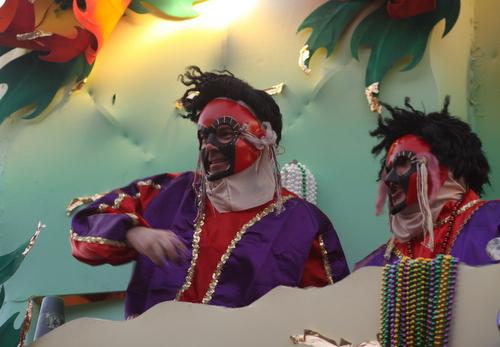 """Riders on the Babylon """"Masks"""" float. (Robert Morris, UptownMessenger.com)"""