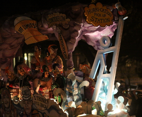 "An Evacuspot statue holding a beverage adorns the front of the Krewe d'Etat ""Hurricane"" float. (Robert Morris, UptownMessenger.com)"