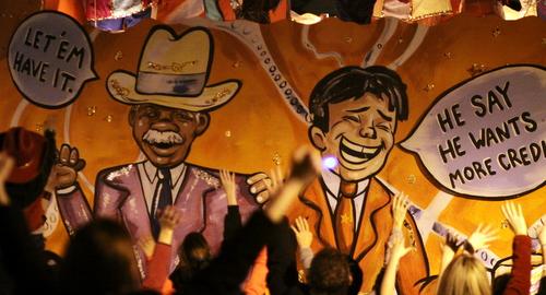"The Krewe d'Etat ""Running a Tab"" float invokes classic New Orleans characters to mock the national debt. (Robert Morris, UptownMessenger.com)"