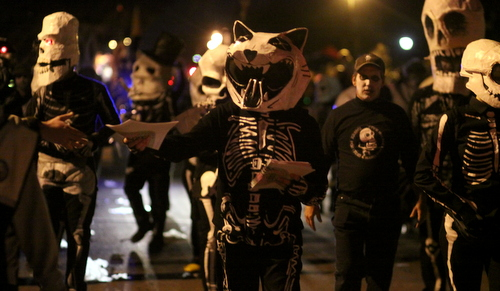 The Skeleton Krewe leads Krewe d'Etat up Napoleon Avenue. (Robert Morris, UptownMessenger.com)