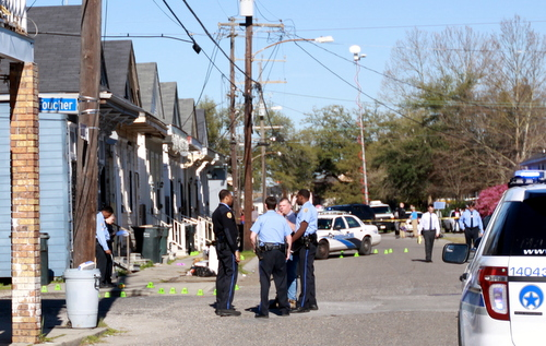 Police officers surround the intersection of Foucher and South Saratoga Streets, where there people were injured in a shooting Thursday afternoon. (Robert Morris, UptownMessenger.com)